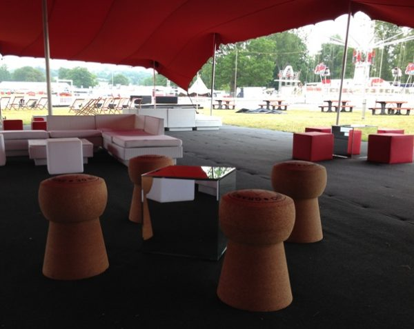 champagne cork stool in marquee at festival in a feild