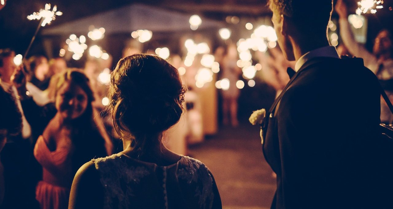 London Wedding Furniture Hire: couple outdoors at wedding with sparklers