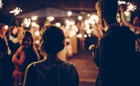 couple outdoors at wedding with sparklers