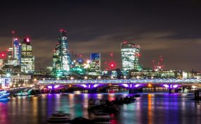 London by night with view of Thames