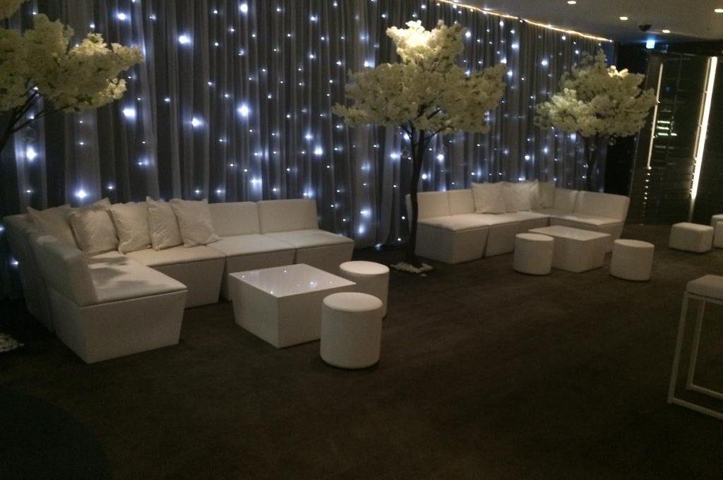 Outdoor Furniture Hire: White Faux Leather Sofa at Bulgari Hotel