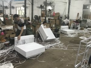 Rattan Hire: Workers weaving white rattan furniture