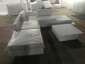 White Rattan Sofas being packed ready for shipping