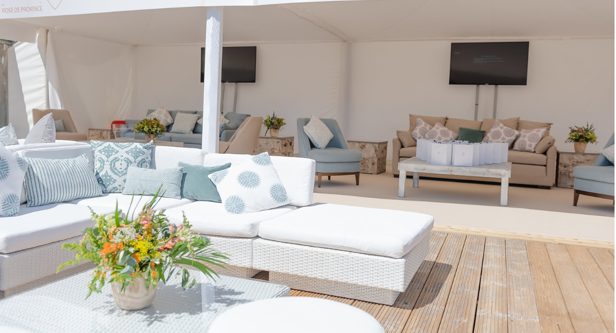 Outdoor Rattan Furniture Hire: white rattan sofas on wooden decking