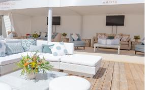 white rattan sofas on wooden decking