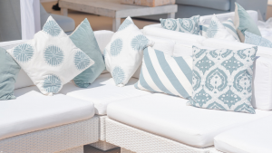 Outdoor Rattan Furniture Hire: white rattan sofas with printed scatter cushions