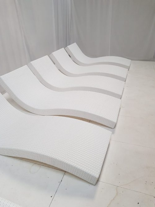 5 curved white rattan daybeds