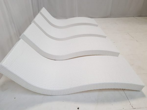 side view of 4 white rattan daybeds