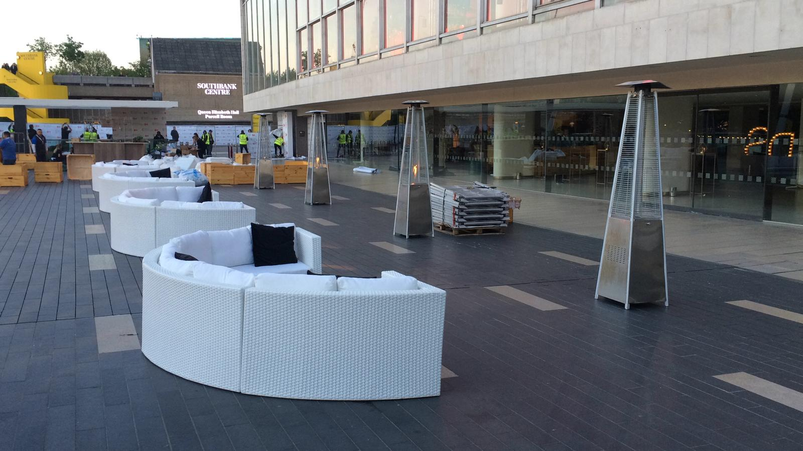 White curved rattan sofas and silver patio heaters outdoors BAFTA awards London South Bank