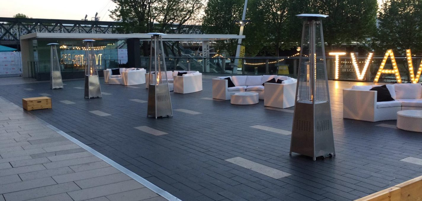Event furniture Hire: Patio heaters and white rattan outdoor sofas at London South bank