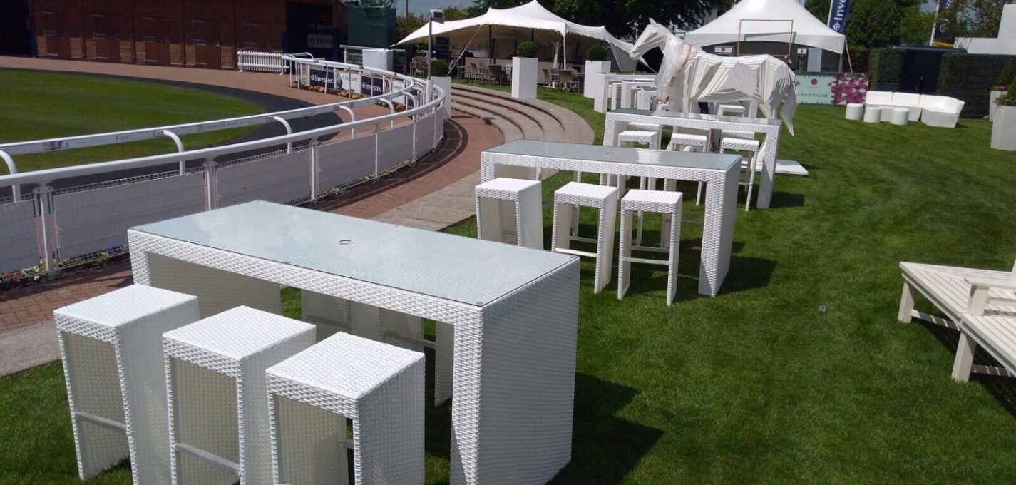 outdoor furniture hire: white rattan bistro tables and stools