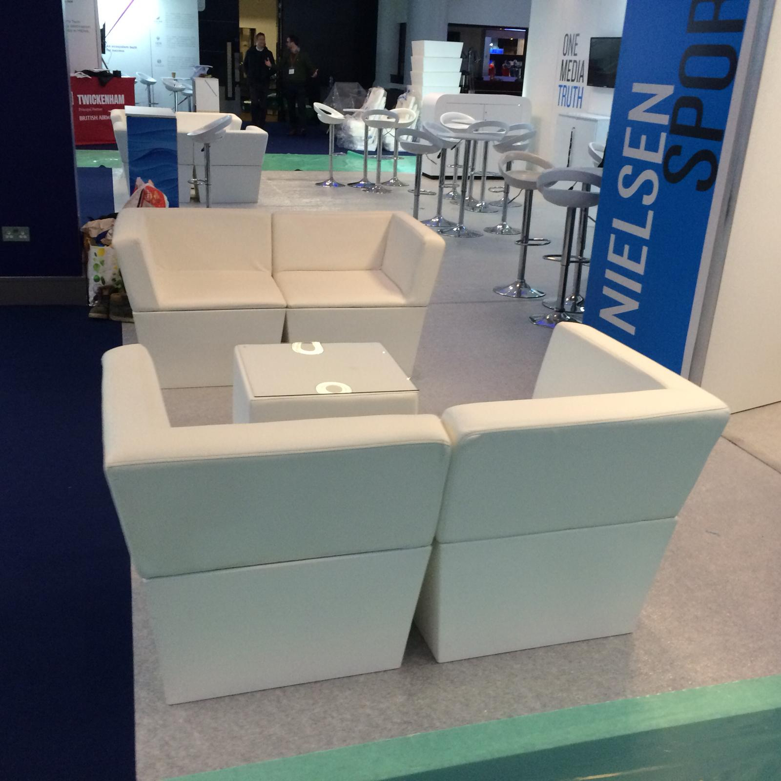 exhibition furniture hire: white faux leather sofa hire at twickenham trade show