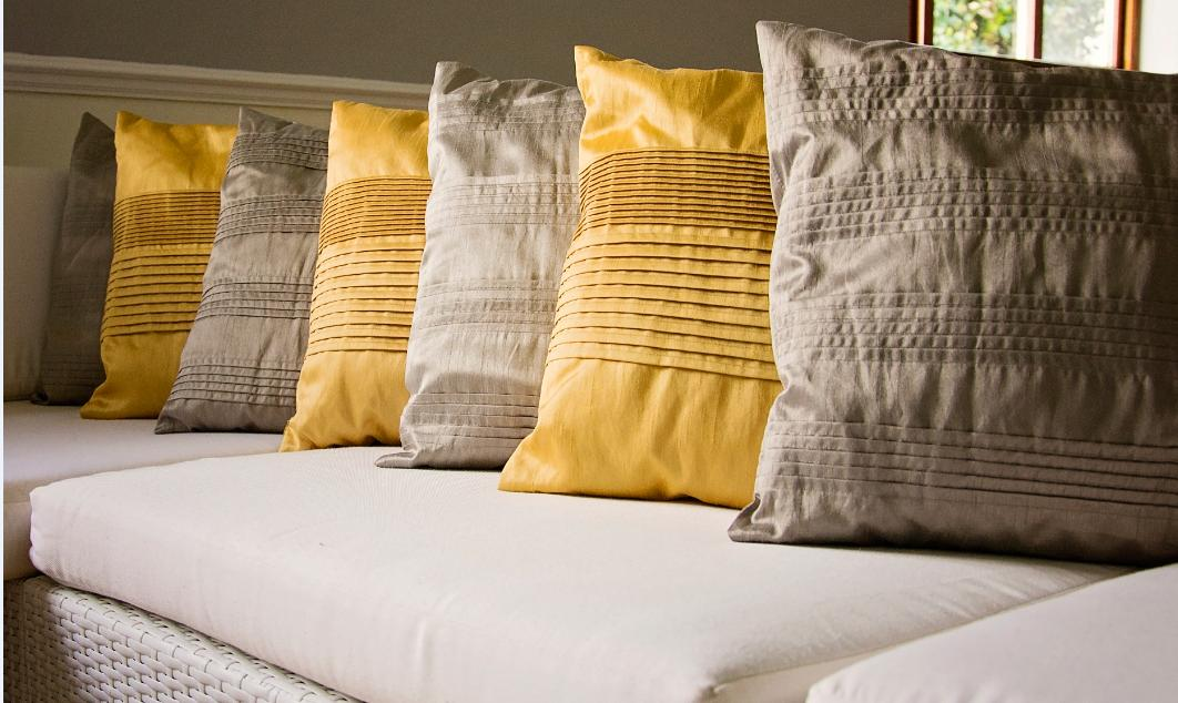 scatter cushion hire: gold and pewter