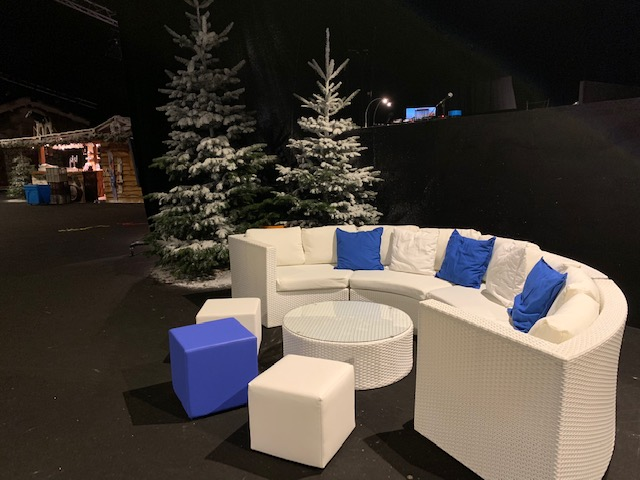 christmas party furniture hire: white sofa with christmas tree