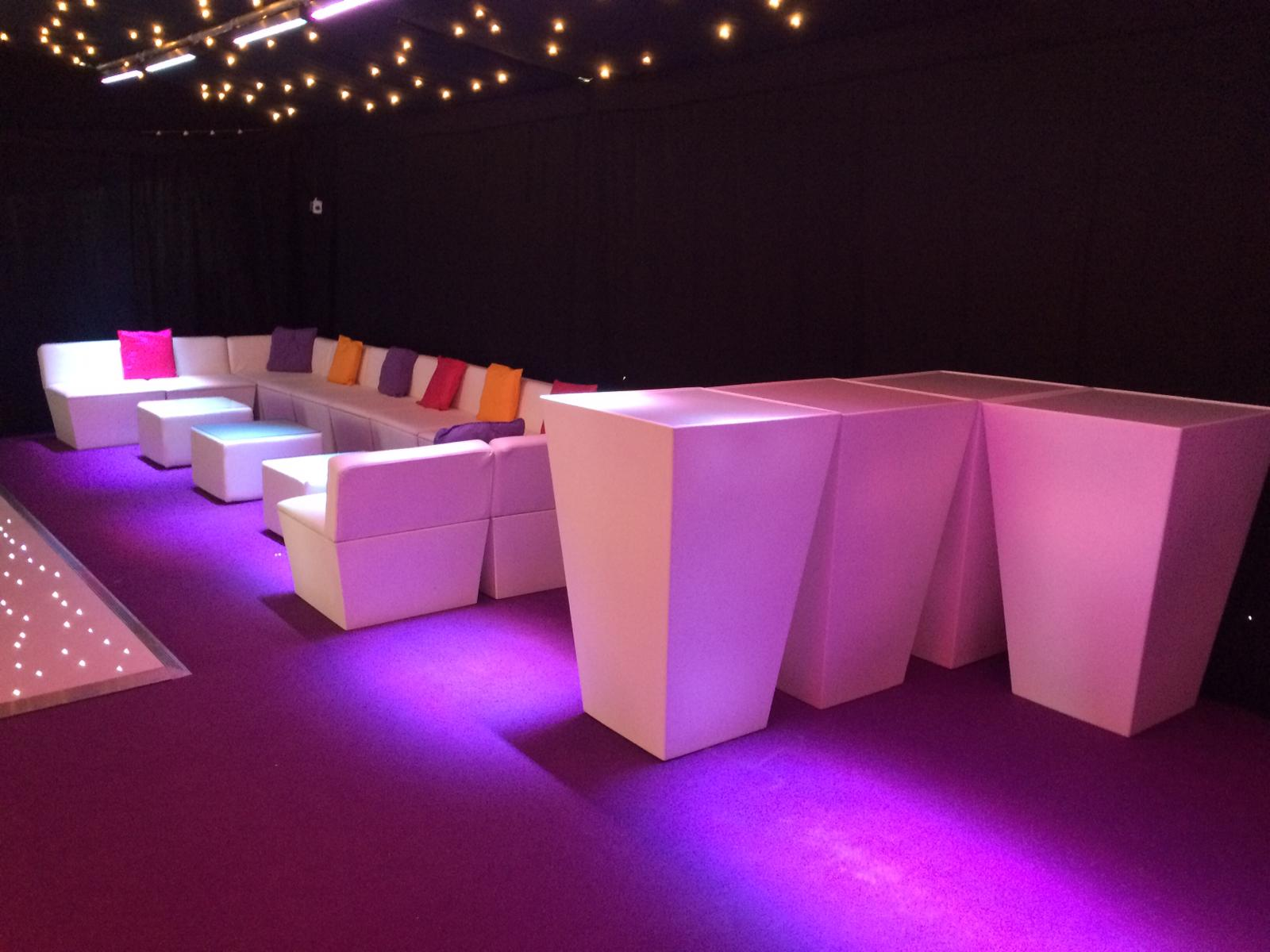 marquee furniture hire: poseur tables and faux leather sofas