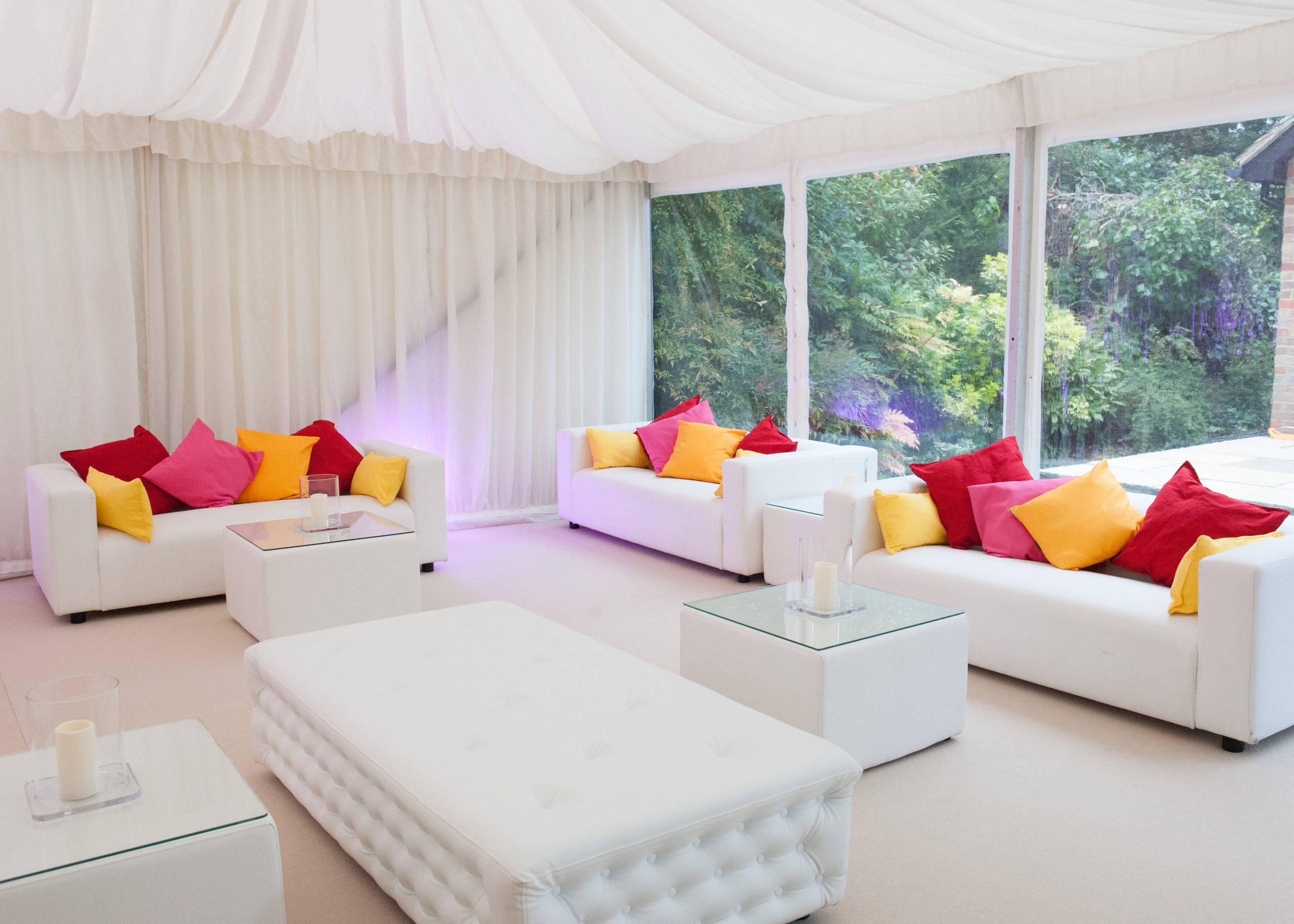 sofa hire: white faux leather furniture hire in marquee