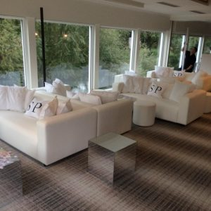 sofa hire: white sofas and mirror cubes