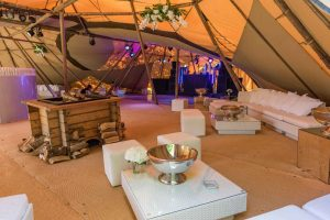 white rattan furniture in stretch tent