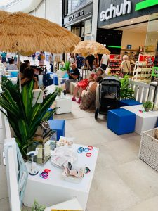 exhibition furniture hire: blue ottomans shopping centre