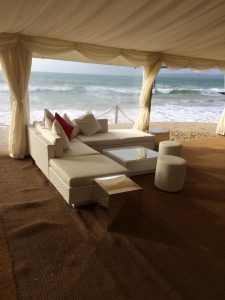 white rattan sofa hire: beach wedding