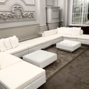 white furniture hire: white rattan sofas with white cushions