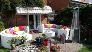 curved white rattan sofas for garden party hire
