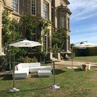 outdoor furniture hire: cantilever umbrellas and rattan sofas