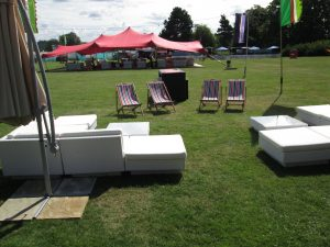 Festival furniture hire: cantilever umbrellas and rattan sofas