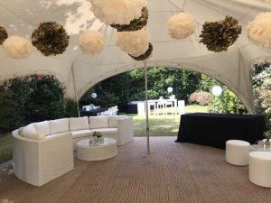 hiring garden furniture : white rattan sofa under stretch tent