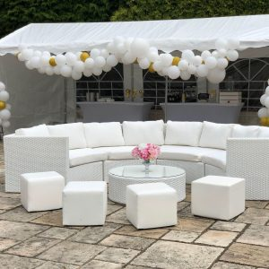 wedding furniture hire: white rattan sofa hire with balloons
