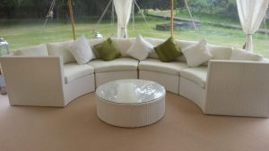 curved white rattan sofa