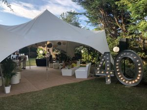 furniture and light up letter hire marquee