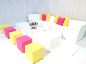 furniture for hire: white faux leather sofas with club ottomans