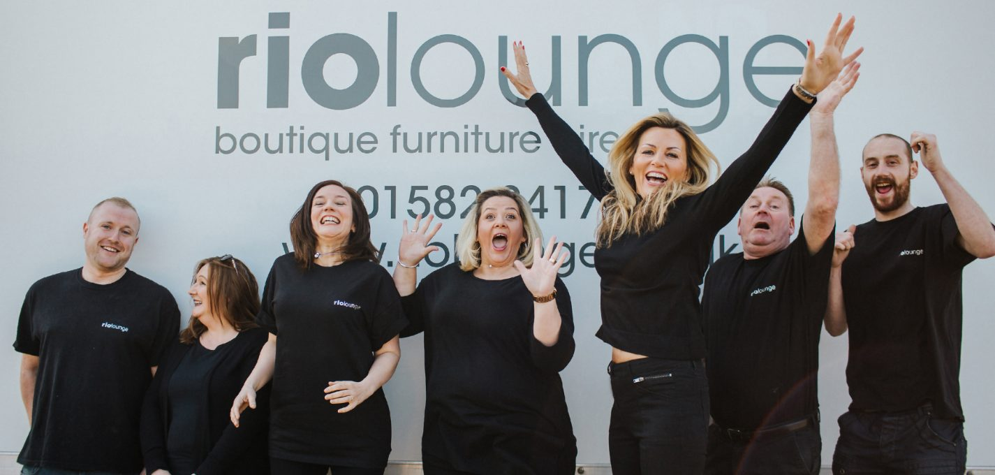 Rio Lounge furniture hire team jumping for joy
