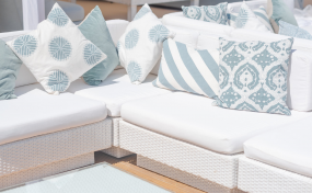 white rattan sofas - garden party furniture for hire